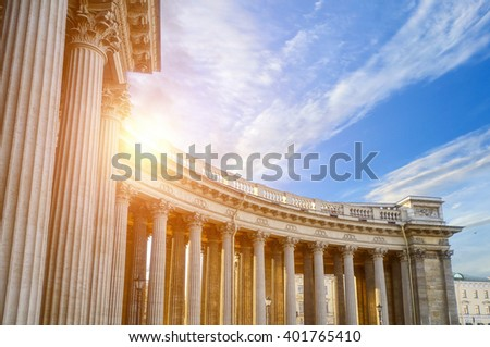 Colonnade of the Kazan Cathedral in Saint Petersburg, Russia. Architectural landscape of famous landmark with sunlight breaking through the balustrade. Soft filter applied.  - stock photo