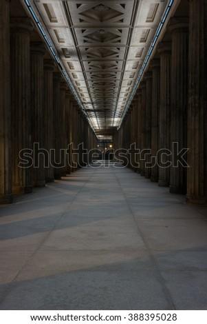 Colonnade receding into the distance. Evening illumination. - stock photo