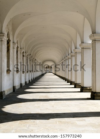 Colonnade with shadows of columns - stock photo