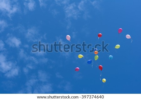Color air balloon on blue sky background - stock photo