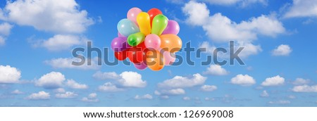 Color Balloons flying in the Blue sky - stock photo