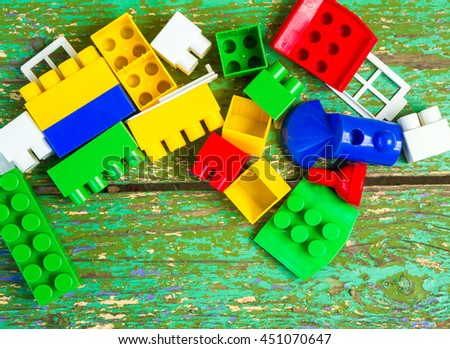 Color block designer on an old wooden surface, kids toys educational