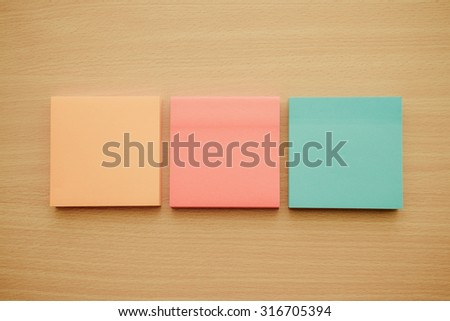 Color block of paper notes on wood table - Retro filter effect - stock photo