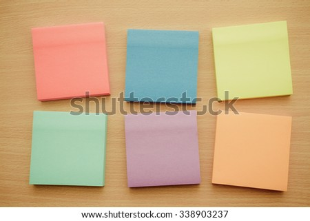 Color block of paper notes on wood table - Retro filter effect
