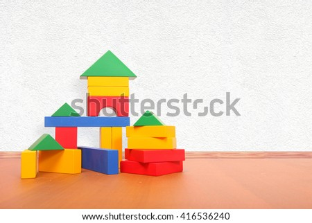 color blocks on the floor in a playroom