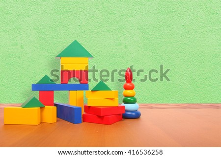 color blocks on the floor in a playroom - stock photo