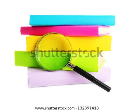 color books with magnifying glass isolated on white - stock photo
