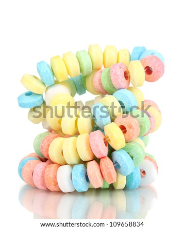Color candies on rope isolated on white - stock photo
