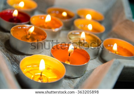 Color candles light background. Holiday candles close up. Abstract glowing background - stock photo