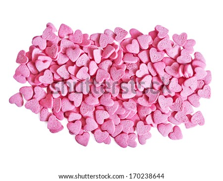color candy hearts on a pink background