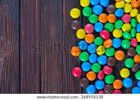 color candy on a table, background from color chocolate candy - stock photo