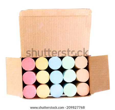 Color chalks in paper box, isolated on white - stock photo