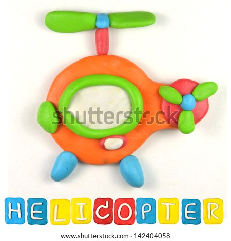 Color children's helicopter plasticine on a white background - stock photo