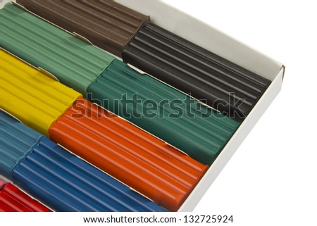 Color children's plasticine in the box on a white background