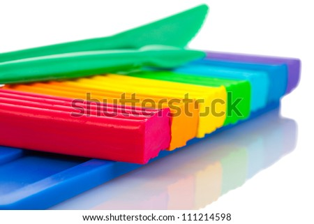 Color children's plasticine on a white background - stock photo