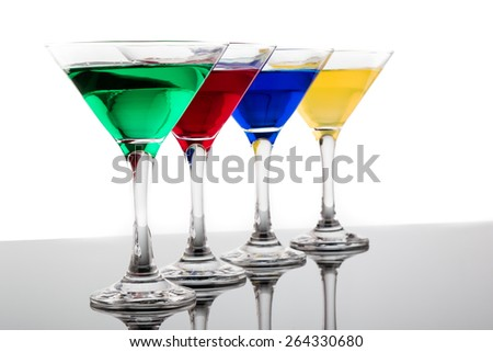 color cocktails in martini glasses organized in a line