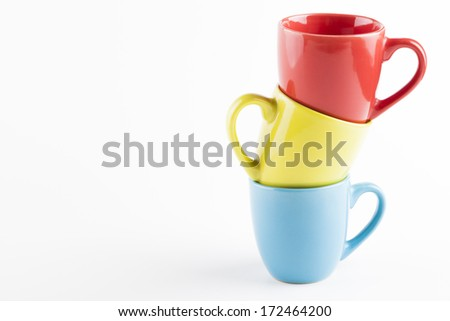 Color coffee mugs pile isolated on white background - stock photo