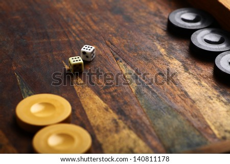 Color detail of a Backgammon game with two dice - stock photo