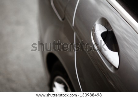 Color detail of a car door handle - stock photo
