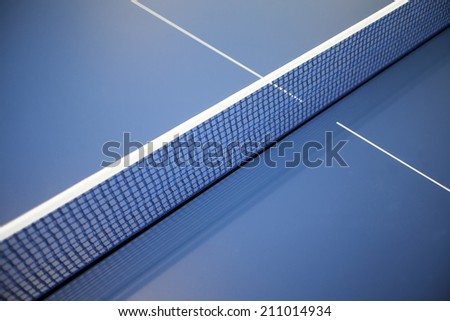 Color detail of a net on a ping-pong table. - stock photo