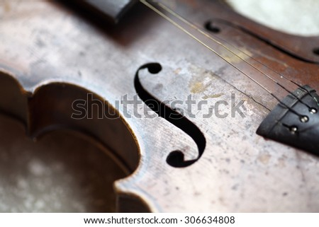 Color detail of a used, old violin. - stock photo