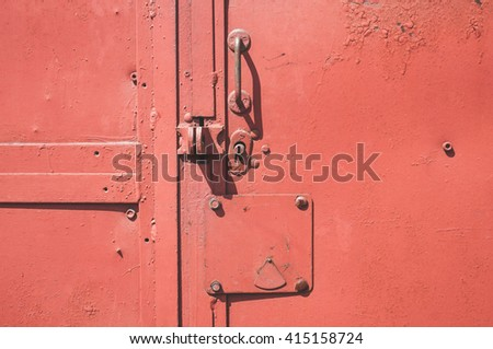 Color detail of a vintage red door handle  - stock photo