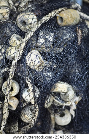Color detail of an old fishing net - stock photo