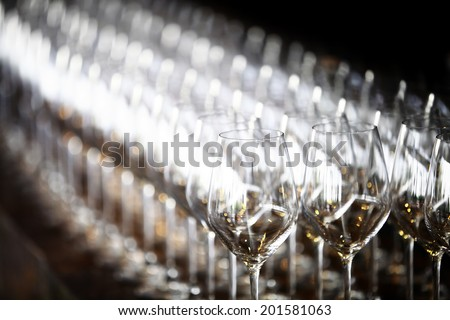 Color detail of some empty wine glasses.