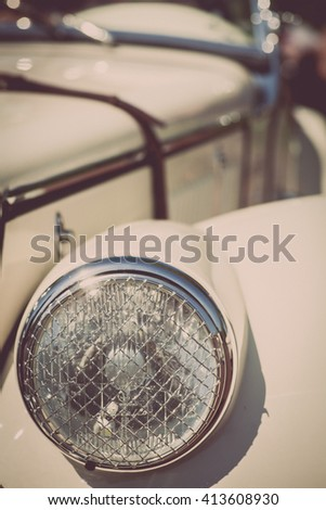 Color detail on the headlight of a vintage car. - stock photo