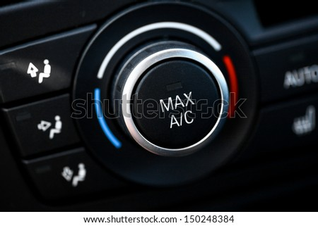 Color detail with the air conditioning button inside a car - stock photo