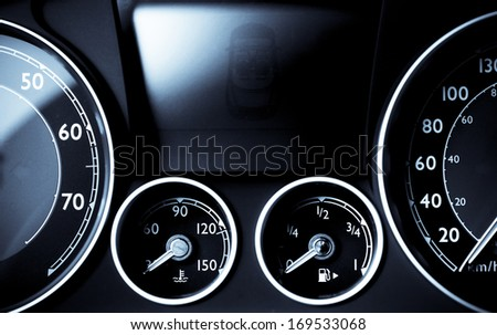 Color detail with the gauges on the dashboard of a car