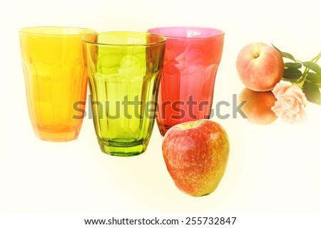 Color drink glasses and fresh fruits. Light (partial) blur effect and light color effect filter. Vintage effect style pictures