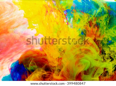 Color drop in water, photographed in motion. Ink swirling in water. Cloud of silky ink in water isolated on white background. Colorful ink in water, ink drop
