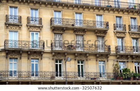 Color DSLR image of apartment building in Paris, France, with windows and balconies. Urban living and homes. Horizontal.