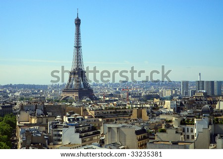 Color DSLR image of Eiffel Tower, Paris, France, in horizontal orientation, with the skyline of Paris in the foreground and background. Copy space for text.