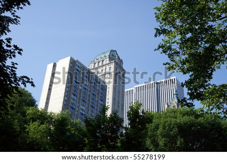 Color DSLR image of New York City buildings and skyscrapers over the tree line in Central Park. Horizontal orientation with copy space for text. - stock photo