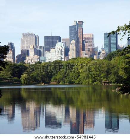 Color DSLR image of New York City Skyline, from Central Park, with reflections in the lake water in the foreground and skyscrapers in background. Horizonatal with copy space for text. - stock photo