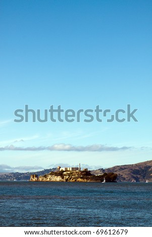 Color DSLR image of The Rock, Alcatraz prison in San Francisco harbor. California landmark tourist attraction. Vertical orientation with copy space for text - stock photo