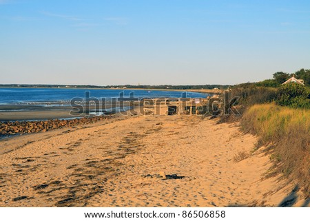 Color DSLR landscape picture of beach scape on Cape Cod, Massachusetts at low tide with golden sunset lighting.  Horizontal orientation with copy space for text - stock photo