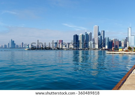 Color DSLR wide angle stock image of downtown Chicago, looking south from Navy Pier; Lake Michigan in foreground; horizontal with copy space for text