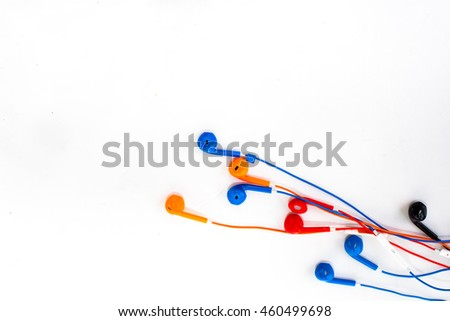 color earphone on background.