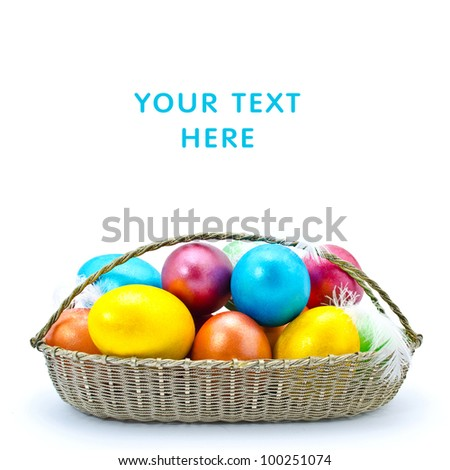 Color Easter eggs in the basket isolated on a white background - stock photo