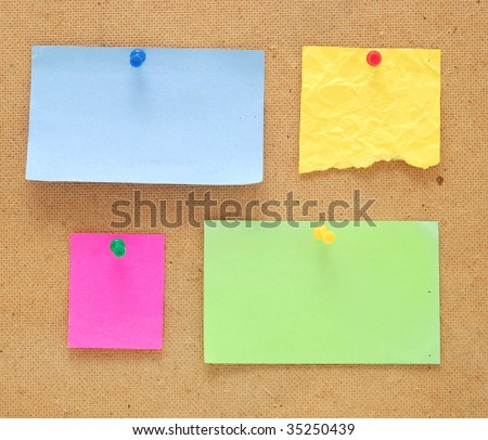 color empty notes on wooden background