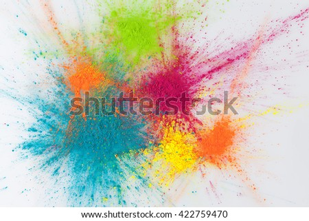 Color explosion concept. Colorful Holi powder exploding on white background - stock photo