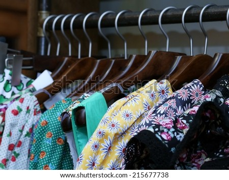 Color fashionable clothes in cloak-room - stock photo