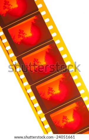 Color film showing a red landscape isolated in white background - stock photo