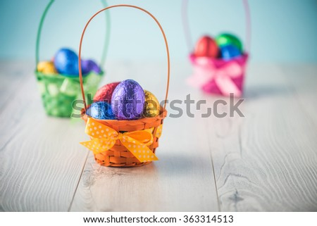 Color full easter eggs in a basket on a white table