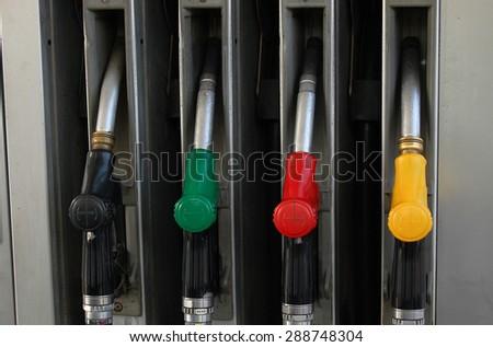 Color full gasoline pump guns at petrol station - stock photo