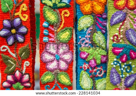 Color full Peruvian embroided flowers on textile - stock photo
