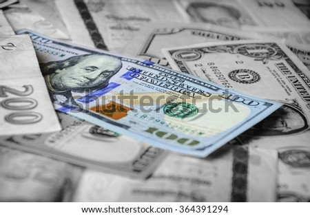 Color greenback on a black and white background of foreign currencies from different countries. Many currencies as background concept global money. Soft selective focus and shallow depth of field - stock photo